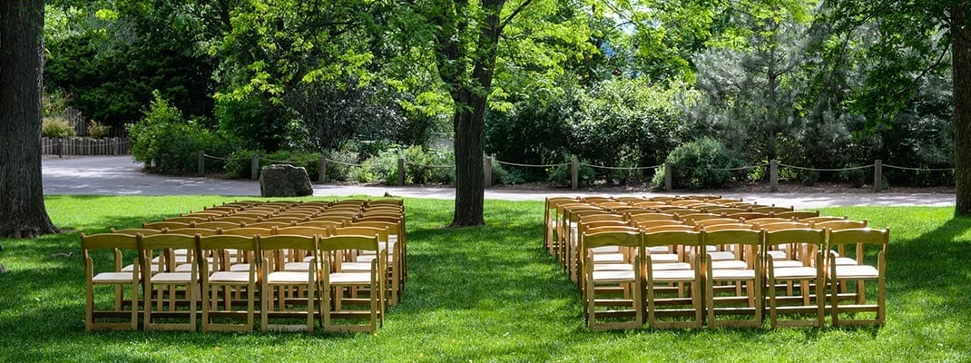 green outdoor area with chairs
