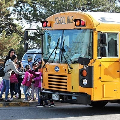 school bus loading in kids to the zoo